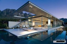 This dramatic contemporary home by SAOTA (Stefan Antoni Olmesdahl Truen Architects) is located in Camps Bay, South Africa.