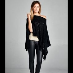 SOLD OUT ! A fabulous poncho Description: Loose fit, round neck poncho. Asymmetrical hem. Fringe detail at hem. This poncho can be worn in many different ways. This poncho is made with sweater knit fabric that is soft and drapes well. Comes in black, navy and taupe! One size fits all... Message me for colors and I'll make a listing for you. If you'd like more than one I'll do a bundle discount  you'll love them ! Strapptz Jackets & Coats Capes