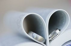 heart shaped book // wedding rings // photography Stella Uys