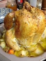 ~Roast Chicken in Bundt pan~1-5 lb chicken, rinsed and dried a couple of potatoes a couple of carrots an onion  some garlic (shaved on my new fancy pampered chef garlic slivererer) salt, pepper, thyme a little oil, olive or vegetable, either is fine