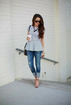 Black and white stripes cute blouse with blue casual jeans and black necklace and leather black hand bag and light brown heels sandal