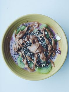 Quinoa breakfast parfait. || Cooked 1/2 cup quinoa with unsweetened vanilla almond milk. Added frozen strawberries + raspberries. Topped with a kiwi + Nature's Path Q'ia Hemp/Chia seed cereal + Trader Joe's creamy almond butter. #vegan #dairyfree #rawfood #breakfastquinoa
