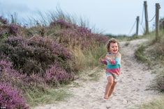 Sarah Gibson's image of a young girl smiling as she runs across a sand dune in Knoll Beach. Julie Thomas, Ireland Pictures, North Somerset, 17th Century Art, Children Images, Luxor Egypt, National Trust, Isle Of Wight, East Sussex