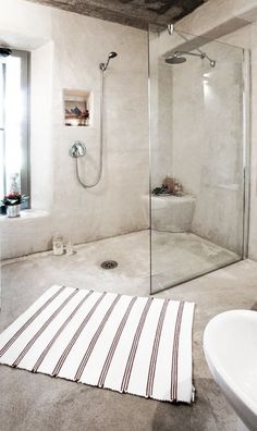 open + airy bathroom shower with a great rug