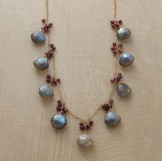 Labradorite briolettes, each crowned with a bubbly cluster of garnets, are evenly spaced along a delicate 14kt goldfilled chain. Handcrafted Sundance exclusive