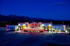 Regal Tikahtnu - TKArchitects, night cinema exterior with beautiful lighting. Cinema Architecture, Construction Cost, Alaska, Exterior, Mansions, Lighting, Night, House Styles, Beautiful
