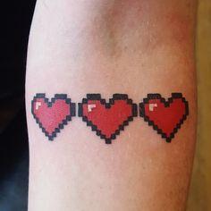 8 bit hearts is tattooed. instagram @2.can.sam : tattoo