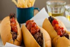 Light the braai and make these quick and easy boerewors rolls with a gourmet-style tomato relish (plus chilli, if you dare). Serve with skinny fries. Braai Recipes, Cooking Recipes, Braai Pie, Hot Dog Rolls, South African Dishes, Tomato Relish, Pub Food, Rolls Recipe, Mediterranean Recipes