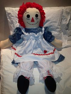 I had a Raggedy Ann and Andy party theme for my daughter.  At each place was eith a Raggedy ann or Andy depending on the gender of the child.  Plus, I had their names embroidered on the aprons of all of them.  It was such a hit.