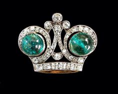 THE ROMANOVS JEWELRY~Imperial Russian presentation brooch in the form of a gold diamond and emerald crown crafted by Faberge's workmaster Victor Aarne. Most likely the piece was made by a Palace order and was presented by a member of the Emperor's Nicholas II family during an earlier occasion like the Emperor's Ascension to the throne. Later this form was used for presents by a 300-year anniversary of The Romanovs.