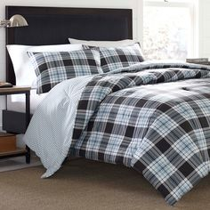 For a traditional yet versatile look, this Eddie Bauer Lewis duvet cover set features a classic plaid print that effortlessly reverses to a sleek striped pattern. In navy multi.