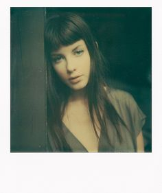 Gorgeous bangs. I'm so jealous. Photography by Laura Taylor.