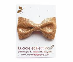 Adorable bowtie #hairclips made offabric with golden glitters. Approximately 6x 3.5 cm,sewn on4.7cm alligator clips. #Hairaccessories available in store.