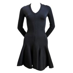 AZZEDINE ALAIA black flared v-neck long sleeved mini dress | From a collection of rare vintage day dresses offered by JENNIFER KOBRIN ViNTAGE at: https://www.1stdibs.com/fashion/clothing/day-dresses/