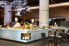 Intercontinental Jakarta-Island Kitchen was made using white stone element at the centre part of the restaurant, where guests can get the authentic cuisines.