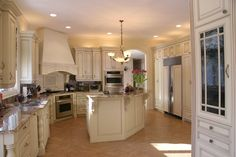 Painted Mitered raised panel doors, kitchen by Adagio cabinets 847-480-6300