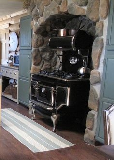 An Elmira stove sits in a rock alcove - Log home, Salida, CO.