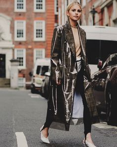 Take a cue from beautiful @carodaur and elevate your rainy day outfit with @calvinklein's PVC covered raincoat we have it in our store! Via @heykarenwoo #FW17 #Sale #StreetStyle