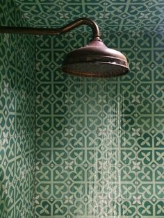 Industrial piping against a bold pattern. Industrial bohemian. Green Shower Rustic shower head