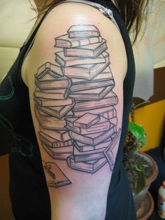 Book tattoo: nice idea, don't like the placement though & spines should have names