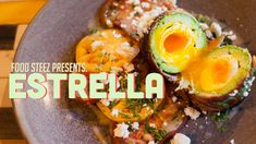 Estrella's 'The Rolling Stone' Dish - poached egg wrapped in avocado & bacon (served with heirloom tomatoes)