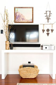 Console vignette with TV - beautiful!! Barely even notice the TV. simple and modern
