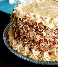 "Dulce de Leche Carrot Cake recipe - ""  Dulce de Leche is a wonderful addition to moist carrot cake, lending its creamy, caramelly sweetness and reducing the sugar usually found in carrot cake recipes. Adding it to the traditional cream cheese frosting took it to another level."""