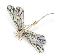 ART NOUVEAU OPAL AND DIAMOND DRAGONFLY BROOCH Mounted en tremblant, the sculpted opal wings decorated with rose-cut diamonds, to the old mine-cut diamond body and 18k gold wirework legs and tentacles, mounted in 18k gold, circa 1900