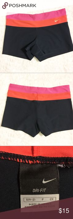 Nike Dri-fit running athletic gym shorts Pink, red and Black Dri-fit running shorts from Nike. In great condition with two minor holes on hand.   Bundle and save with other athletic wear in my closet! Nike Shorts