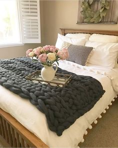 I think one of these chunky arm knit blankets would make our new house look more cozy!!