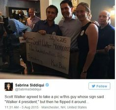 Scott Walker posed for the picture without reading the sign, smart man! #2016elections #DOWNWITHTHEGOP #feelthebern