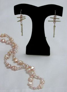 Ruth Mary Pollack pearl necklace, and Julie Shmidt earrings.