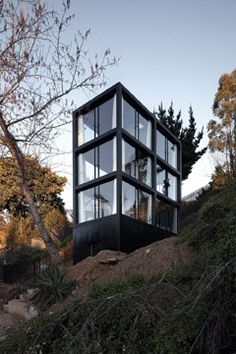 This earthquake-proof house on a hillside in western Chile designed by architects Pezo von Ellrichshausen has six rooms with glass artitecture ideas architecture Architecture Résidentielle, Container Architecture, Amazing Architecture, Contemporary Architecture, Installation Architecture, Architecture Magazines, Design Exterior, Interior And Exterior, Pezo Von Ellrichshausen