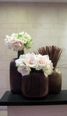 contemporary floral arrangement - palest pink in dark wood