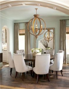 Classic and elegant | chandelier + tufted chairs + round dining table + floor mirror