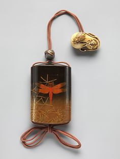 Case (Inrô) with Design of Dragonfly (obverse); Praying Mantis (reverse)  Period: Edo period (1615–1868) Date: 19th century Culture: Japan Medium: Case: powdered gold (maki-e) and colored lacquer on black lacquer; Fastener (ojime): metal with design of dragon blossoms.