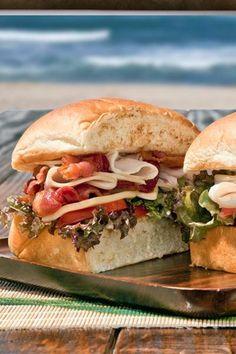 The Kauai Club Sandwich, piled high with turkey, crisp bacon, lettuce and tomatoes on a King's Hawaiian Bun.