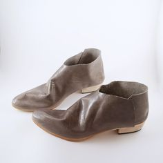 You know those perfectly broken in booties? Get instant gratification with this one! This limited edition Terilyn boot is made with the softest glove leather in a very beautifully vintaged look pearl grey. This is not a rugged boot, but if you've ever wondered what the softest boot in the world was like...here you go!I can honestly say that this is the most comfortable shoe ever...leather like butter! This unique one piece hand lasted design is near impossible for factory machines to…