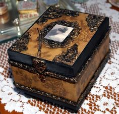 vintage jewlery box, altered cigar box embellished  with polymer clay: