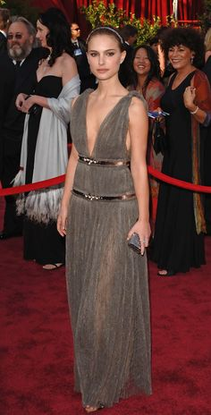 Natalie Portman, 2005 Natalie Portman was darkly romantic in a Grecian-inspired gown and matching diadem by Lanvin. The beautiful young actress wore tiny pearl earrings in liieu of diamonds.