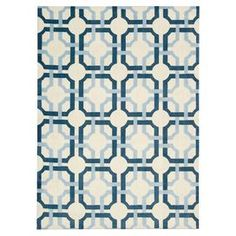Evoking beautifully tiled floors, this handmade rug showcases a sophisticated lattice motif in a sky-hued palette.    Product: RugConstruction Material: 100% PolyesterColor: Teal and sky blue Features: HandmadeNote: Please be aware that actual colors may vary from those shown on your screen. Accent rugs may also not show the entire pattern that the corresponding area rugs have.