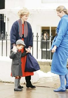 On January 15, 1987, Prince William holds  the hands of his mother, Diana, Princess of Wales as he is greeted by headmistress, Miss Frederica Blair-Turner on his arrival for the first day at his new school, Wetherby, a pre-preparatory school for boys. Wetherby is located in Penbridge Square, London, a short drive from his home in Kensington Palace.