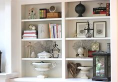 shelf styling--and she has those vintage clocks set to the times that her children were born. love that idea!