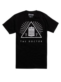 """The Doctor has encountered more than his fair share of pyramids. Now the TARDIS has found another one. """"The Doctor"""" is printed beneath this <i>Doctor Who</i> TARDIS pyramid graphic on a black T-shirt. The mystery is yours to solve.<div><ul><li style=""""list-style-position: inside !important; list-style-type: disc !important"""">100% cotton</li><li style=""""list-style-position: inside !important; list-style-type: disc..."""