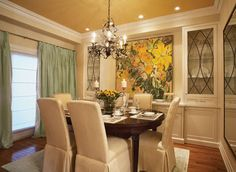Ceilings with color!  While the default paint option of most dining room ceilings is white, why choose what everyone else has chosen? This ceiling paint is the true star of the room--with the neutral Delaware Putty on the walls hanging back and letting the star shine. See Other Ceiling Color Ideas  Paint is from Benjamin Moore:  Delaware Putty Chestertown Bluff