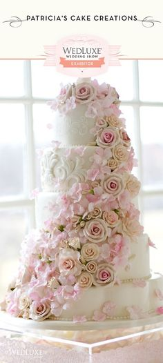 Beautiful White Wedding Cake & cascade of roses in pink and white ..lots of beautiful detail on this cake.