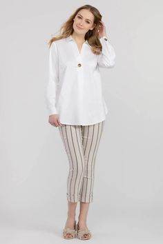 A single tortoise-style button takes this crisp versatile white shirt from simple to statement. Its roll-up sleeves, rounded hem, and relaxed fit make for an effortless look that can easily transition from office to brunch. It has an accent button detail, Roll-up sleeves, a rounded hem, and Stretch fabric. 98% Cotton, Roll Up Sleeves, Stretch Fabric, The Selection, Chic, Tortoise, Cotton, How To Make, Brunch, Shirts