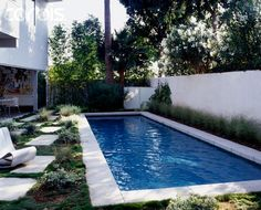 Large lap pool hidden with a white concrete wall