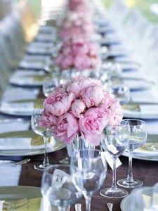 Pink peonies on white wedding table