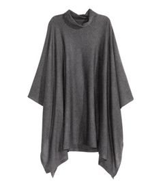 Soft, fine-knit, turtleneck poncho with wool content.